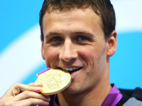 Olympian Biting Gold Medal